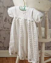 http://www.letsknit.co.uk/free-knitting-patterns/easy-lace-christening-gown