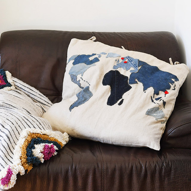 Learn how to utilise old denim jeans to add a world map to a floor cushion. Tutorial by Pillar Box Blue.