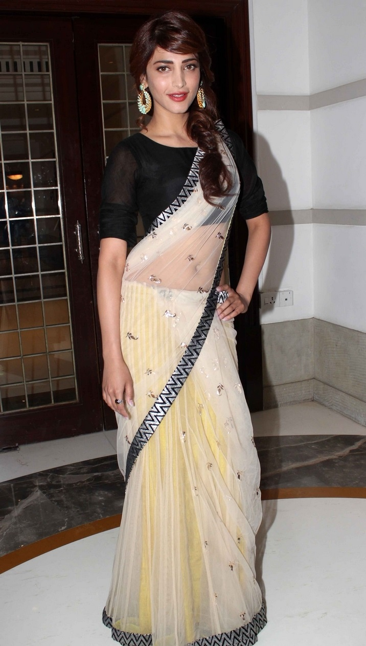 Actress Shruti Hassan In Transparent Yellow Saree