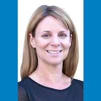 Professional headshot of Rio Salado Dean of Instruction and Academic Affairs Shannon McCarty with solid blue horizontal banners.