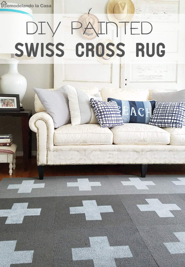 plain gray rug is transformed with paint and cross template