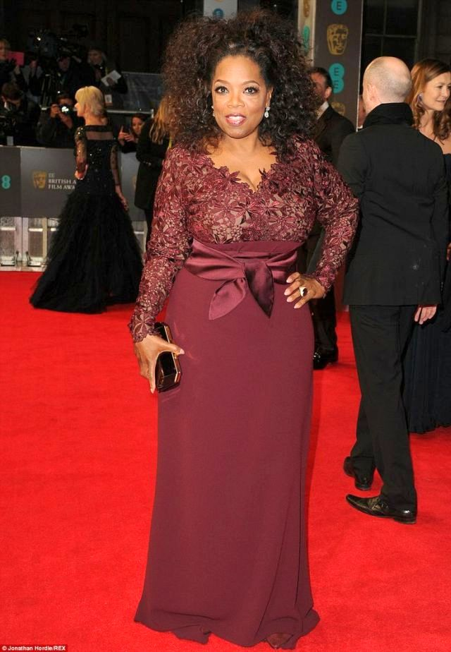 Oprah Winfrey in a berry-coloured Stella McCartney gown at the BAFTA 2014