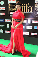Apoorva in a Stunning Tight Leg Split Sleeveless Red Gown at IIFA Utsavam Awards 03.JPG
