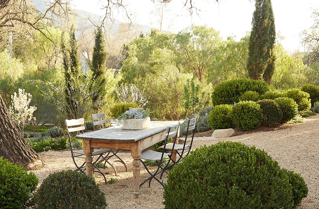 Beautiful modern farmhouse outdoor dining area on gravel at Patina Farm...decor inspiration on Hello Lovely Studio