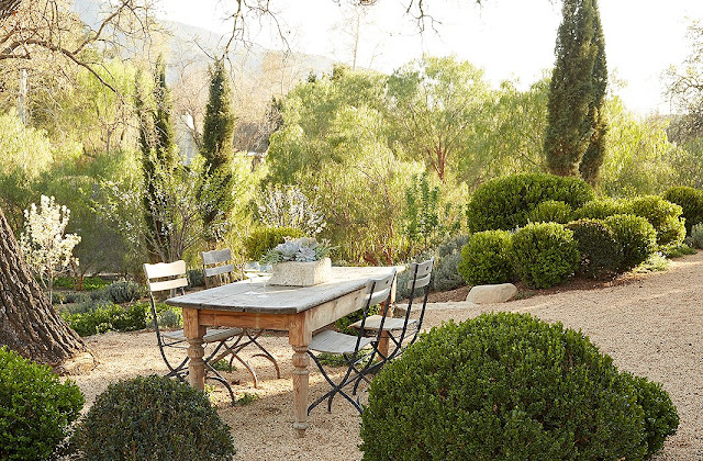 Beautiful modern farmhouse outdoor dining area on gravel at Patina Farm...decor inspiration on Hello Lovely Studio