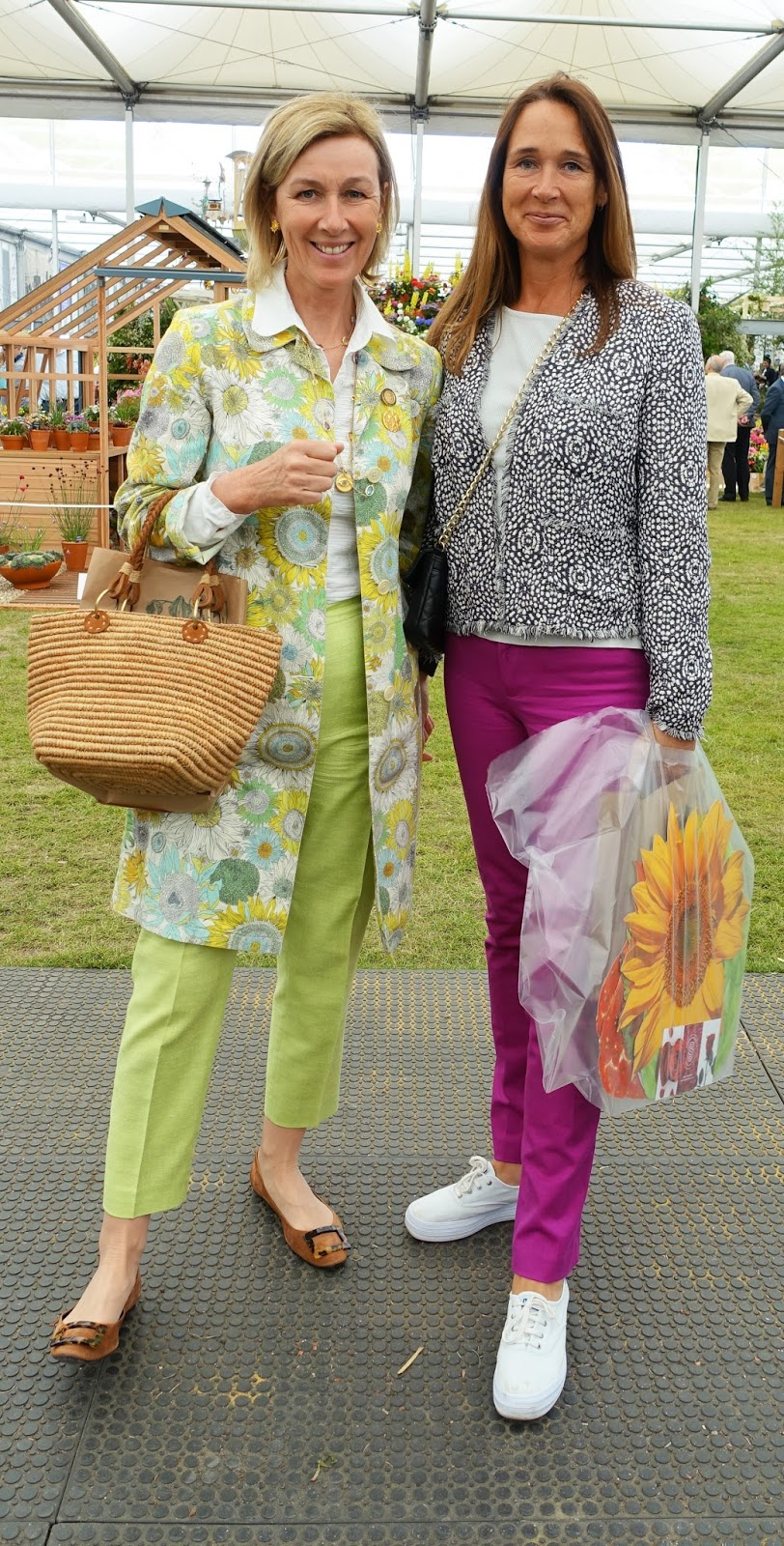 Two ladies in lime green and magenta, Chelsea Flower Show 2017