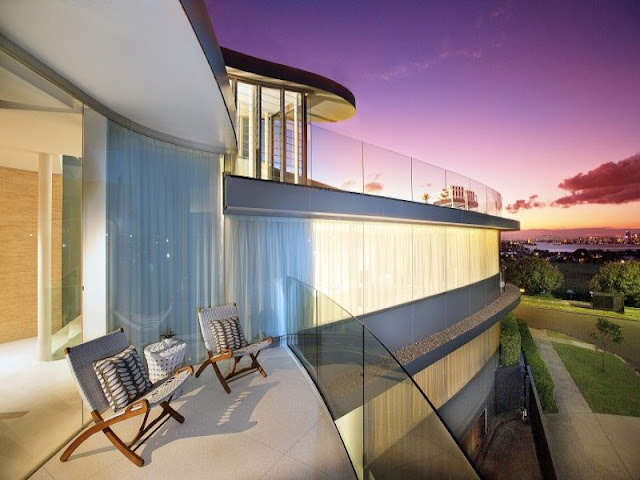 Modern house from the terrace at sunset