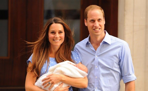 Hello world! A newborn Prince George is shown off by his proud parents in July 2013