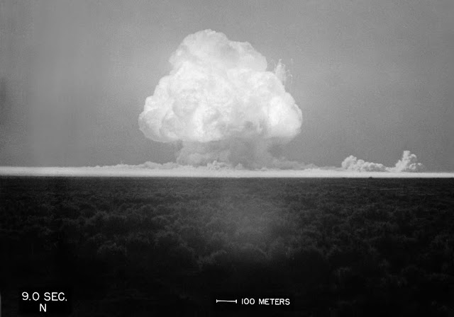 A fireball begins to rise, and the world's first atomic mushroom cloud begins to form, nine seconds after Trinity detonated on July 16, 1945.
