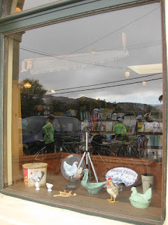 Cyclists reflected in window at the San Gregorio Store