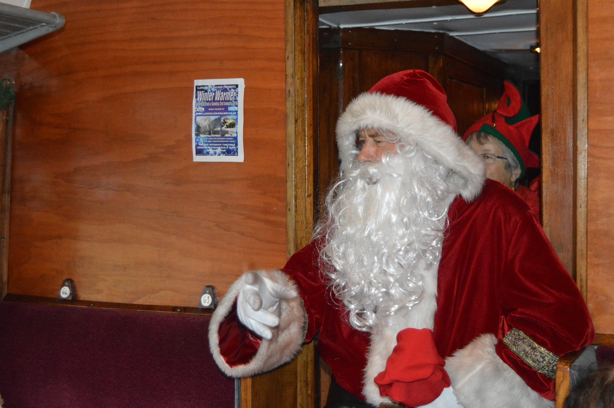 Santa walking through the train carriage