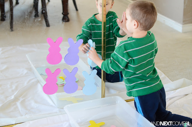 Easter sensory bin for toddlers using water and foam bunny shapes