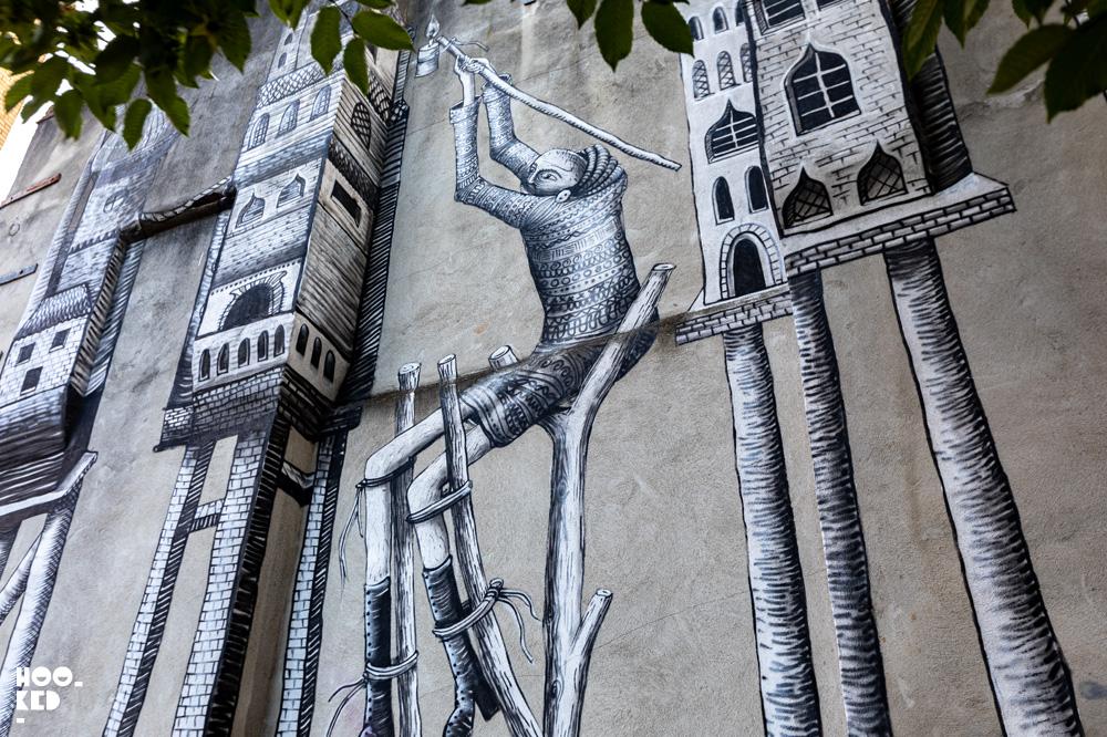 Black and white street art mural by UK artist Phlegm