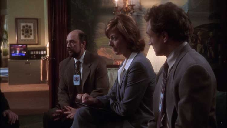 Allison Janney, Richard Schiff, and Bradley Whitford in The West Wing episode Pilot.
