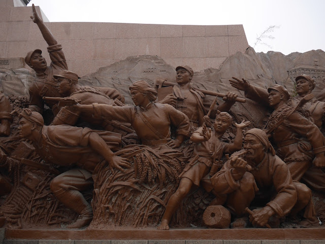 figures surrounding the Mao Zedong statue in Shenyang, China