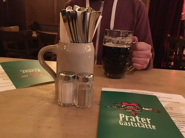 Food menus and a pint of beer at prater garden berlin