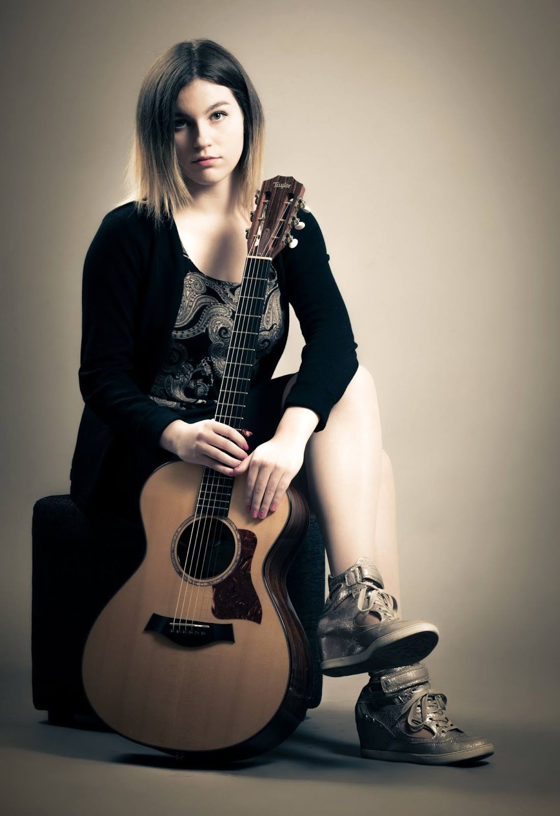Gabriella Quevedo - She revives goldie oldies on her guitar.