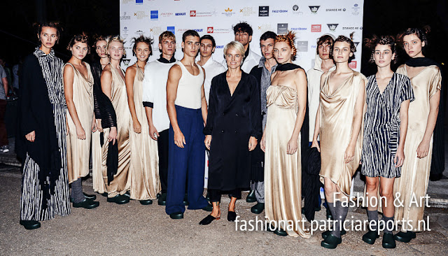 Orsalia Parthenis with the models of the fashion show Exaggerated Individualism Spring-Summer 2018 at AXDW