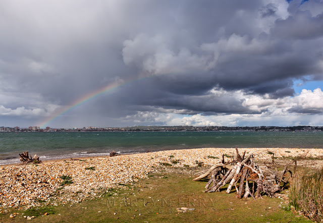 Rainbow arches over the Poole coast from Brownsea Island in Dorset
