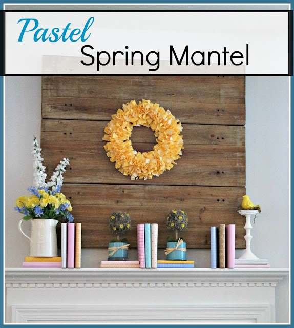a Spring mantel done in pastels with paper covered books. diy topiaries, a diy fabric rag wreath and faux flowers in a vintage pitcher - all done on a budget