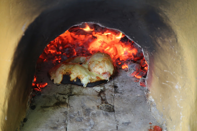 Making pizza in a wood fired cob oven, Norfolk