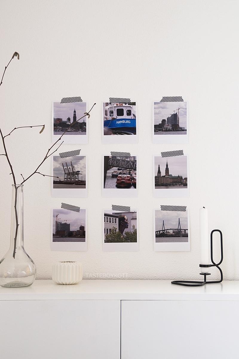 scandinavian minimalistic white january wall decoration with polaroid photos