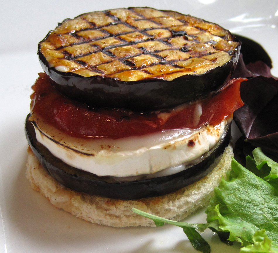 Aubergine Tomato and Goats Cheese Stacked on Garlic Bread