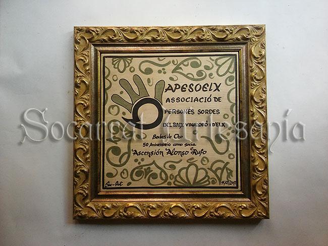 Socarrat 30x30 con enmarcación dorada elegante, realizado con óxido de cobre y manganeso. Socarrat Artesanía