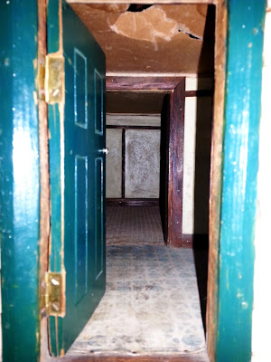 Inside view of a 1930s vintage dolls' house bungalow through the front door.