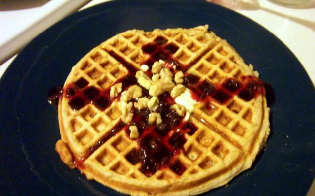 Waffles loaded with bananas and covered with walnuts and a berry maple syrup...yum!  Banana Waffles with Maple Walnut Syrup -Slice of Southern