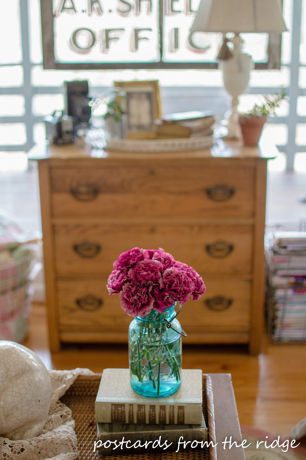 pink carnations in a vintage blue mason jar for spring