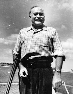 Ernest Hemingway with a rifle at the Club de Cazadores del Cerro in Rancho Boyeros