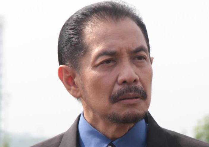 Erwin Bagindo Pemeran Pak Aswan