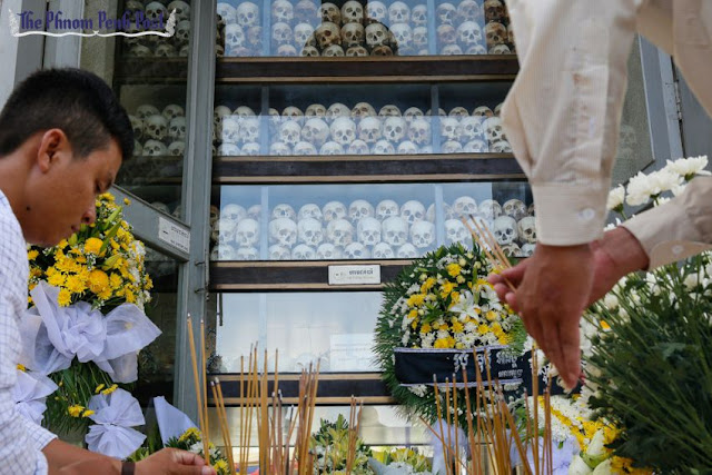People place incense at the Choeung Ek killing fields memorial site in Phnom Penh's Dangkor district to mark the annual 'Day of Anger' in 2015. Pha Lina