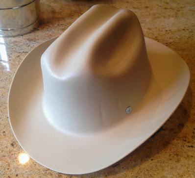 khaki cowboy helmet