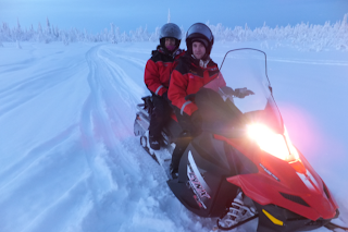 Arctic road trip journey - winter holiday in sweden - snowmobile