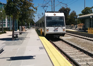 VTA light rail train pulling into station, Sunnyvale, California