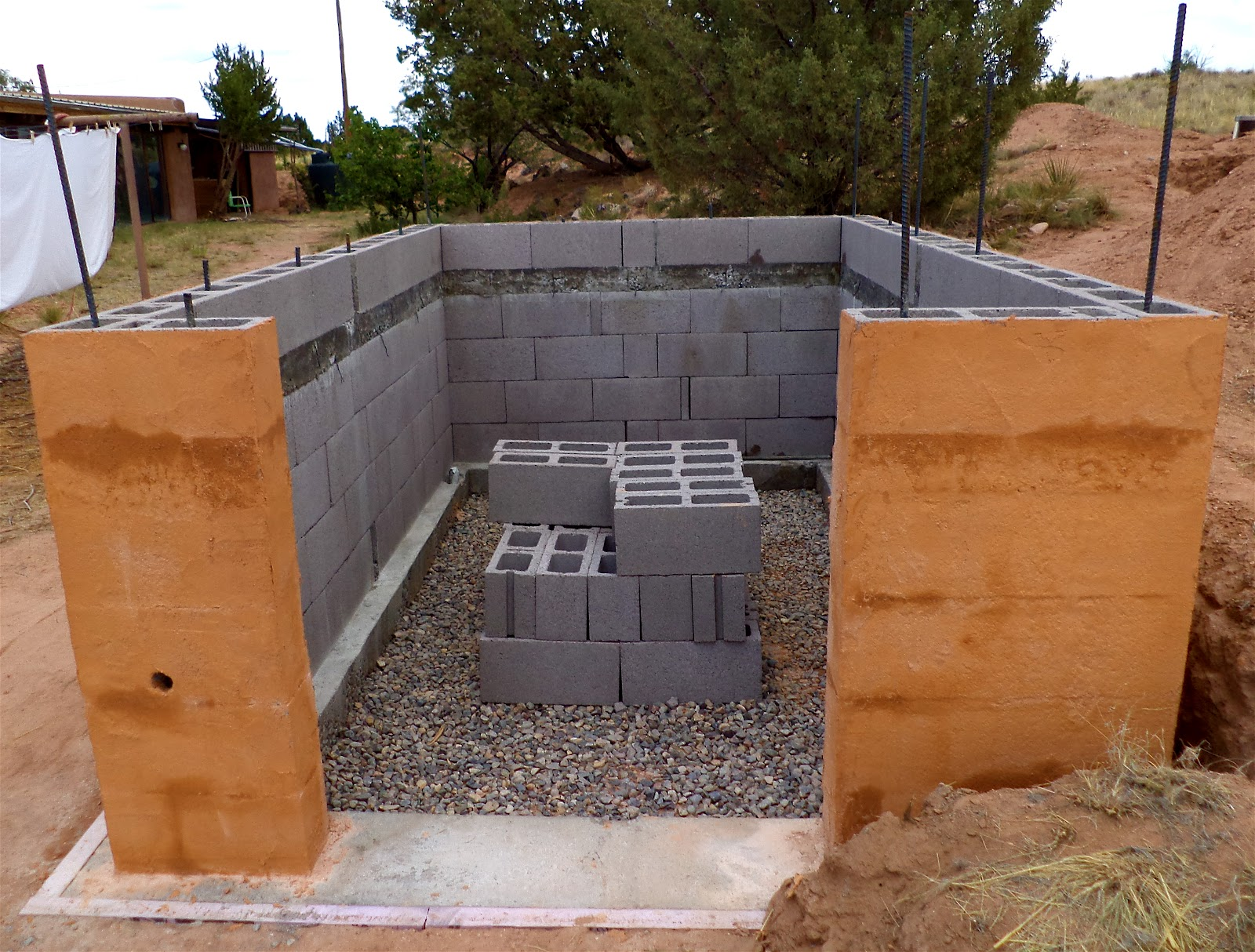 Alt build blog building a well house 2 dry stack for Cinder block house construction