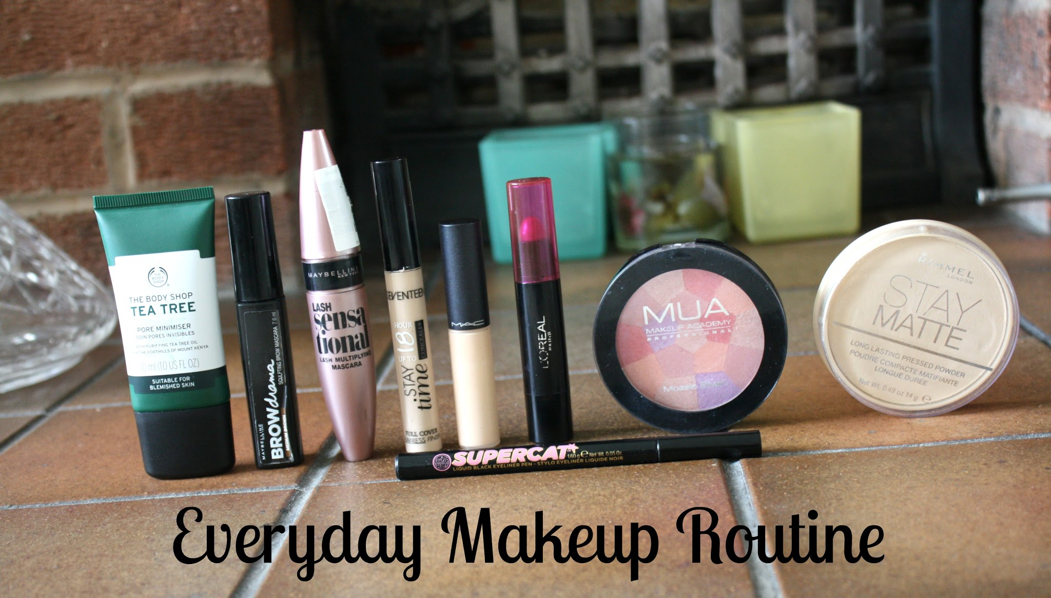 line of makeup products on fireplace maybelline loreal bodyshop soap and glory