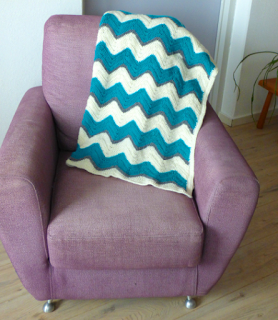 Zigzag chevron afghan draped on chair