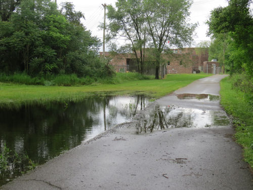 flooded paved multi-use trail