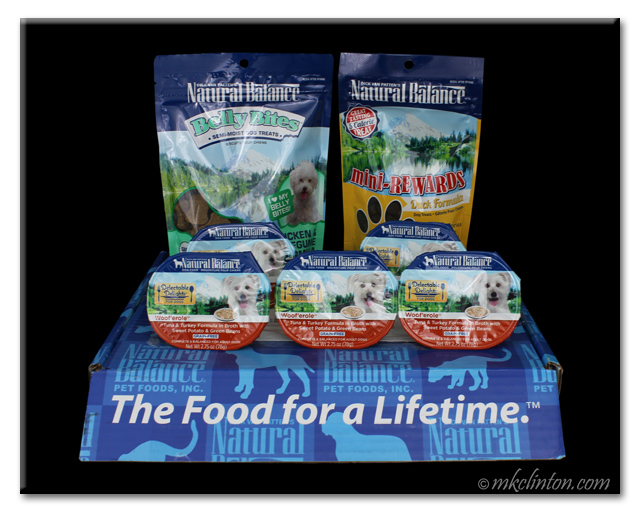 Natural Balance Treats and wet cups on top of blue Natural Balance box