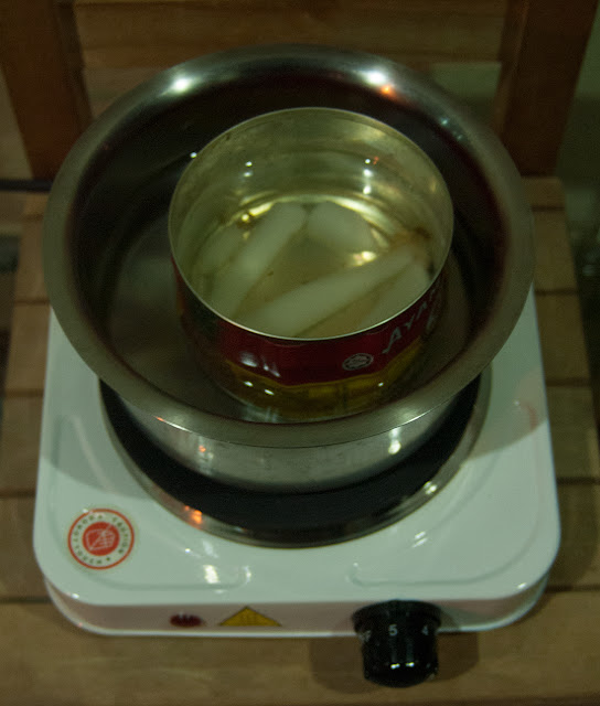 Double boiler to melt paraffin wax and turpentine