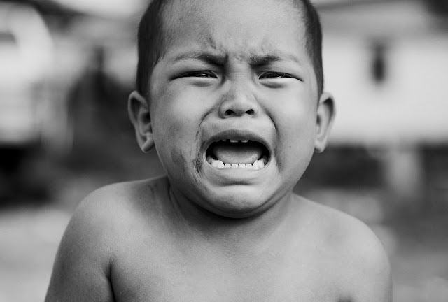 Young boy crying, angry