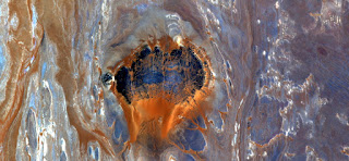 Devil's throat,abstract landscapes of deserts of Africa ,Abstract Naturalism,abstract photography deserts of Africa from the air,abstract surrealism,mirage in Sahara desert,fantasy forms  and color