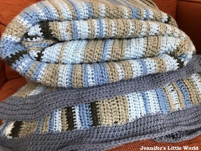 Finished crochet Sky Blanket rolled up
