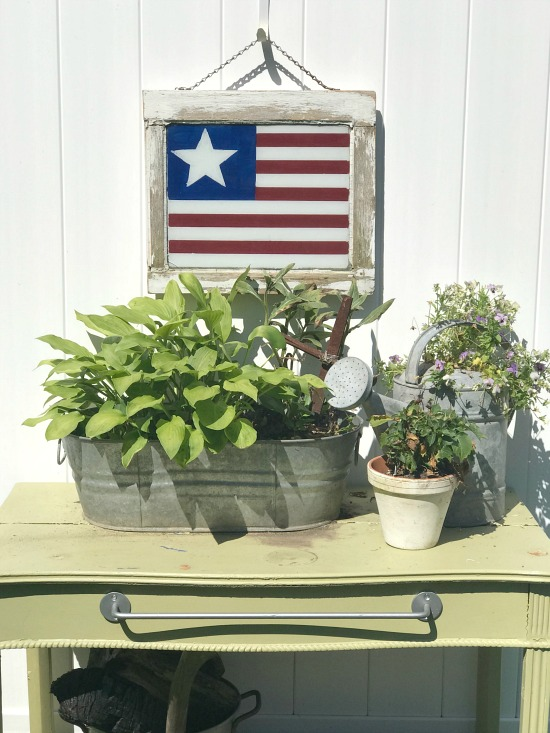 American flag window and plants and potting table