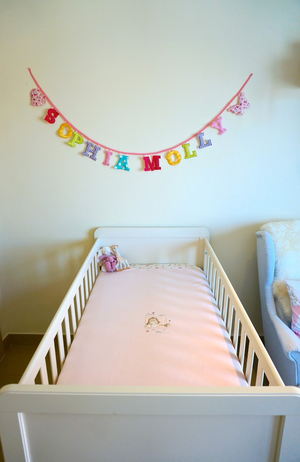 Sophias nursery reveal follow your sunshine along the wall next to the cot are several wardrobes full to the brim with travel cases baby baths muslins blankets and her clothes and maybe a few of amipublicfo Gallery