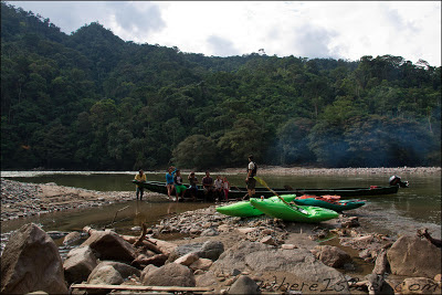 Giorgio making friends with a local fishing family, Chris Baer, Colombia, Rio Caqueta
