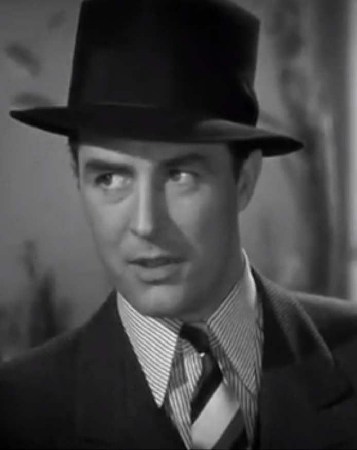 33f6eedd Ray Milland wearing a fine striped shirt with a broad striped tie. The  bolder tie takes the attention and the similar patterns in different scales  don't ...